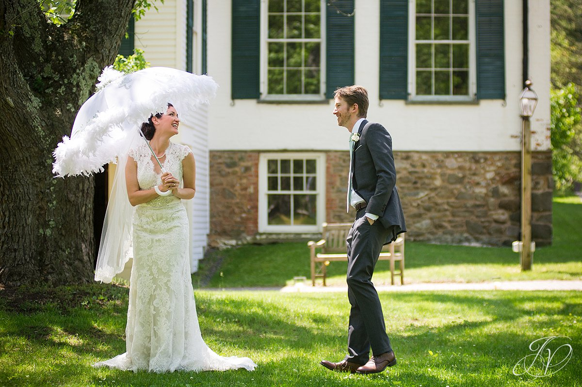 candid bride with umbrella, handsome groom with bride candid, Albany Wedding Photography, pruyn house wedding, Wedding at The Pruyn House
