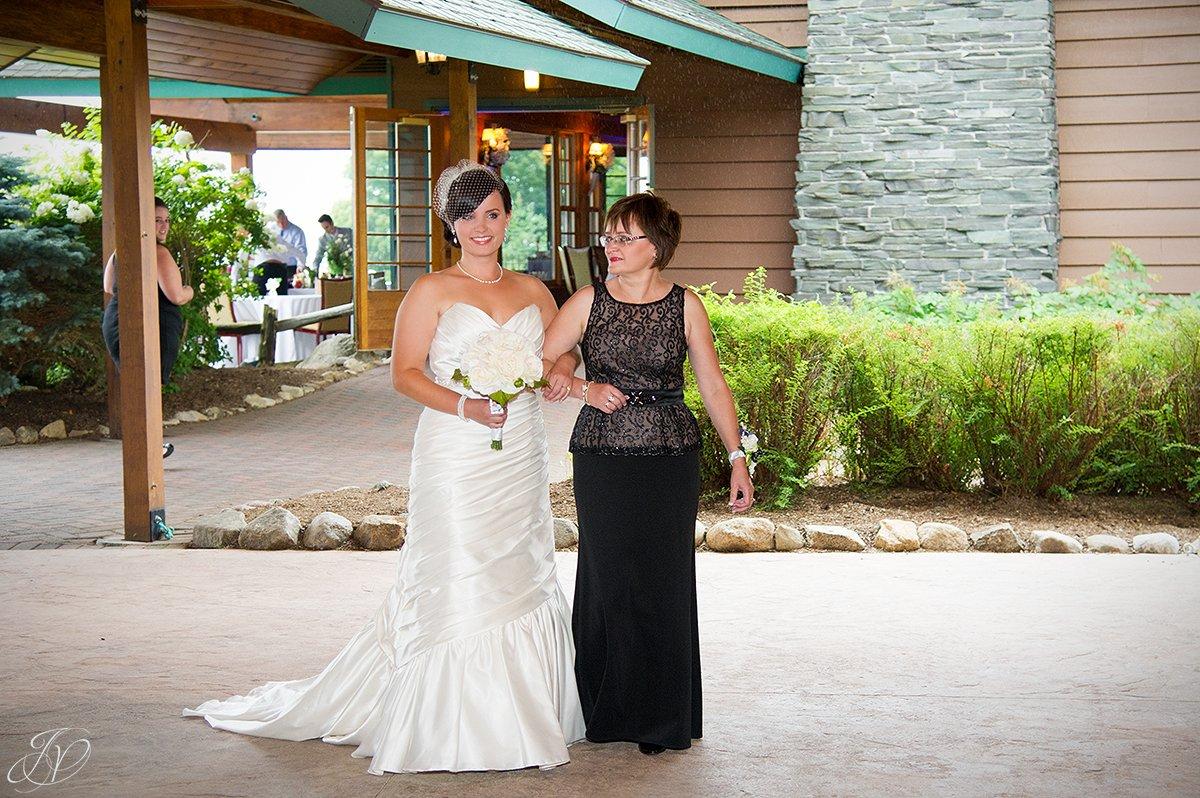 mom walking bride down aisle