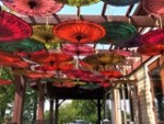 Umbrellas!  Metropolitan installing these 100 hand made/painted umbrellas for a wedding at Burritt