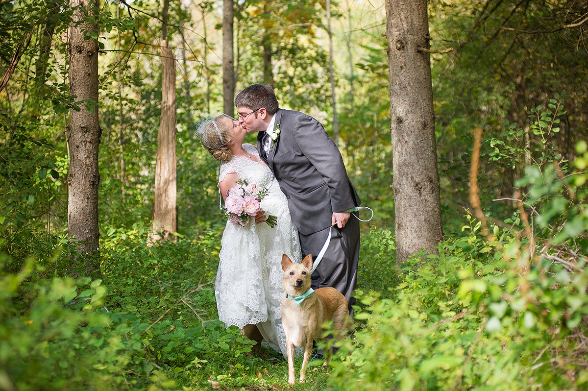 sweet photo of bride and groom with their dog