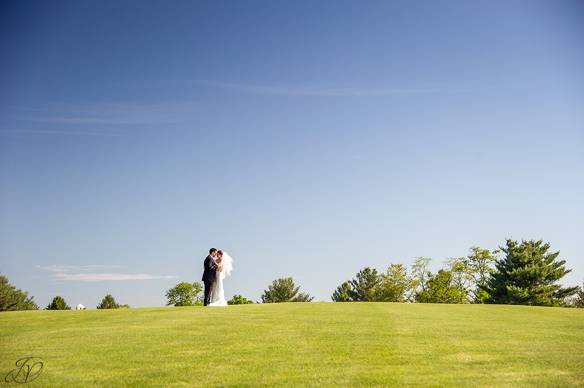 bride and groom golf course photo