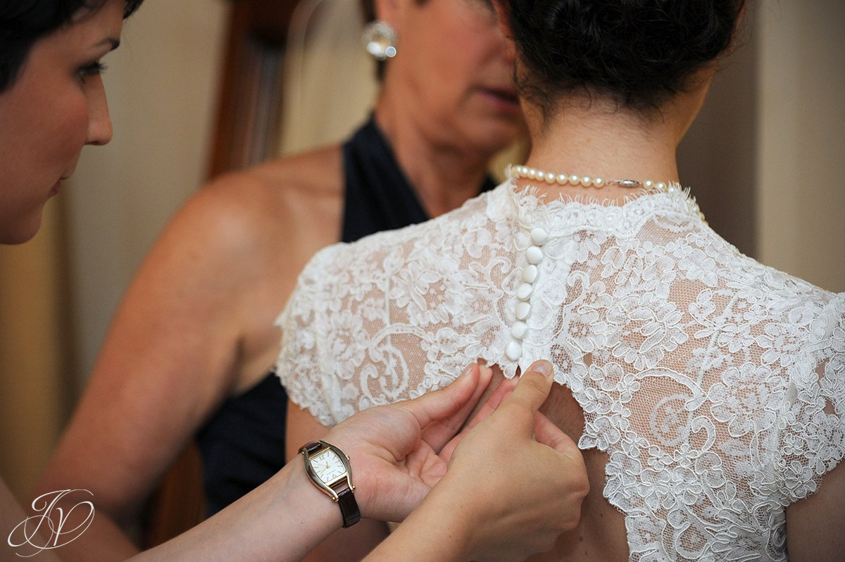 buttoning up wedding gown, Wedding at The Pruyn House, Albany Wedding Photographer