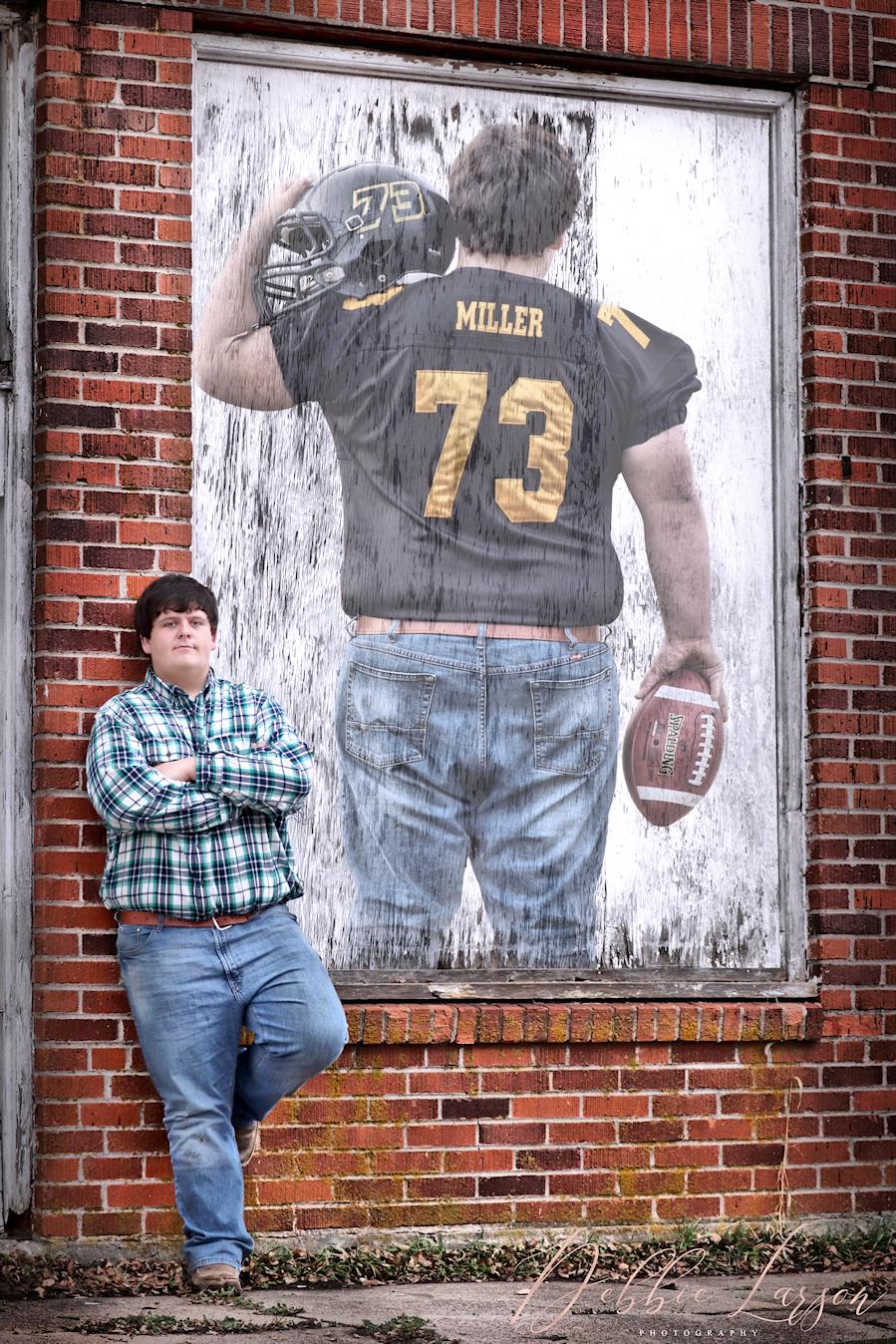 senior boy picture brick wall debbie larson photography