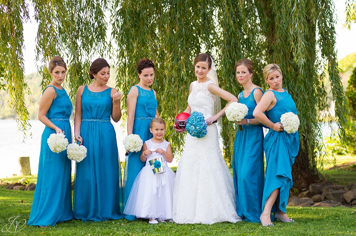 funny shot of bridesmaids doing the pose from bridesmaids