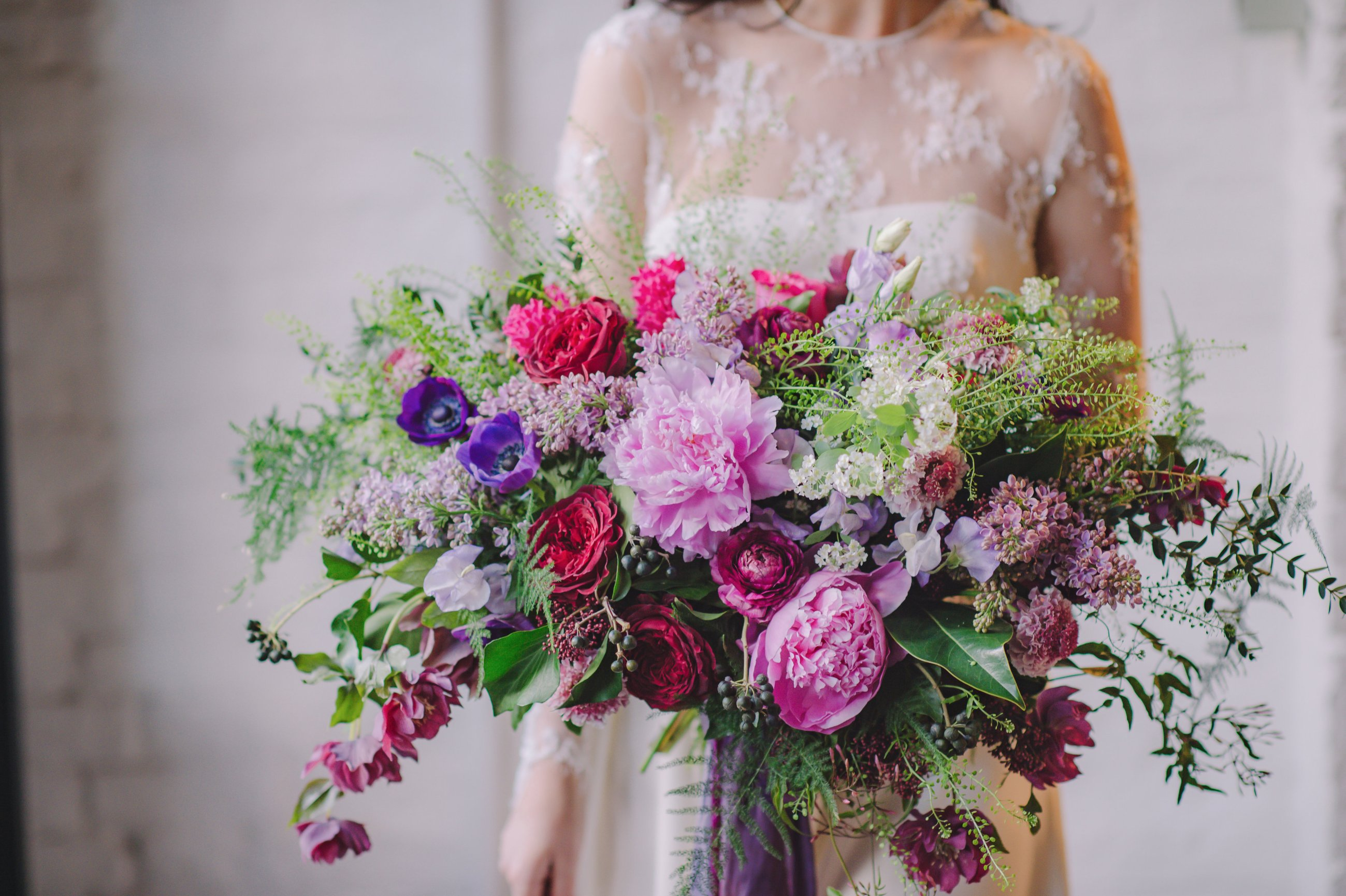 Free form a new style of bridal bouquet an oversized free form english garden style bouquet designed with anemones ranunculus peonies garden roses lilacs lisianthus flowering scabiosa izmirmasajfo