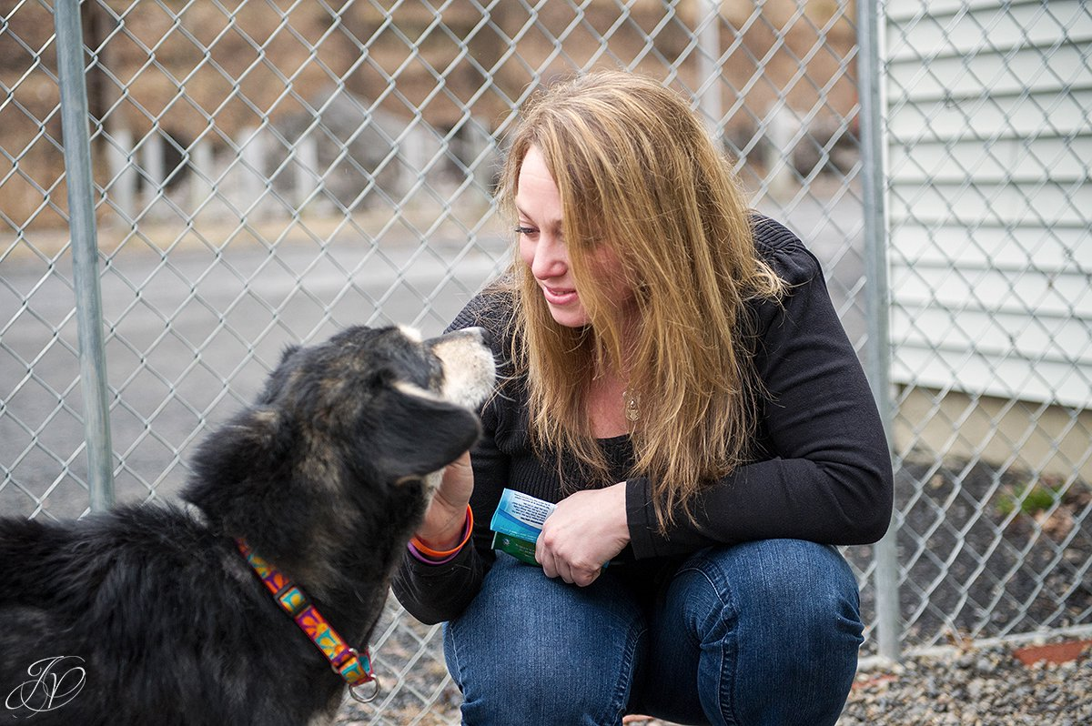 woman with rescued dog photo, regional animal shelter, dog rescue photo, rescued dog photo, canine skin disease photo