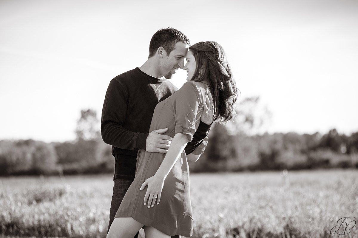 cute couple dipping in black and white photo