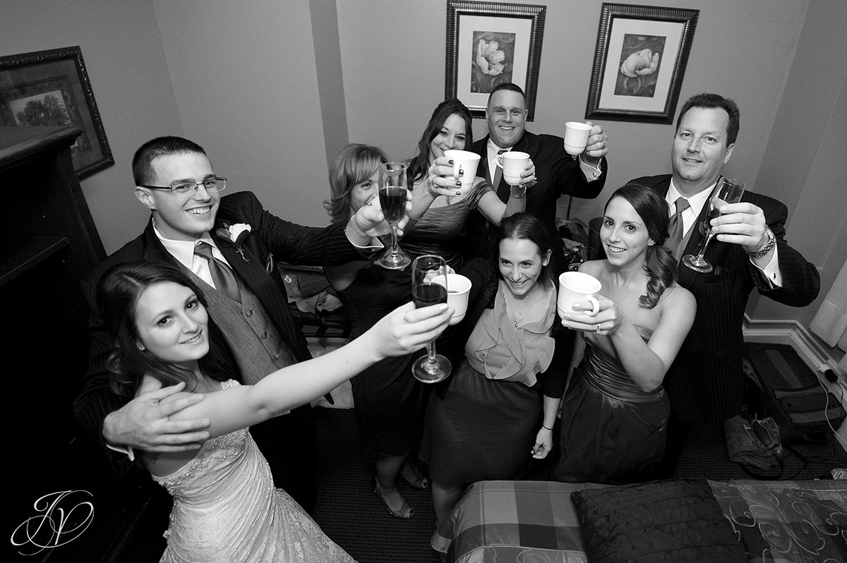 family toast photo, extra special wedding toast, bride partying photo, bride dancing candid, Schenectady Wedding Photographer, The Stockade Inn, Reception candid photos, guests dancing candids, reception at the stockade inn