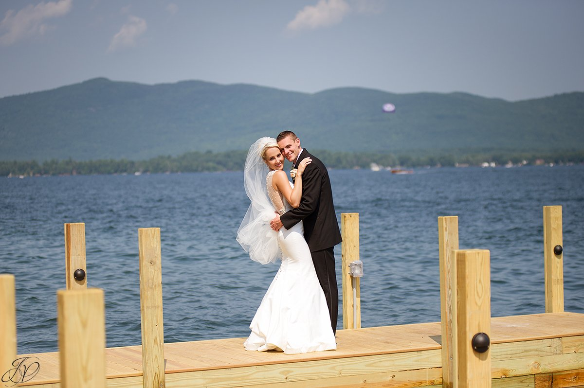 bride and groom on dock on lake lake george