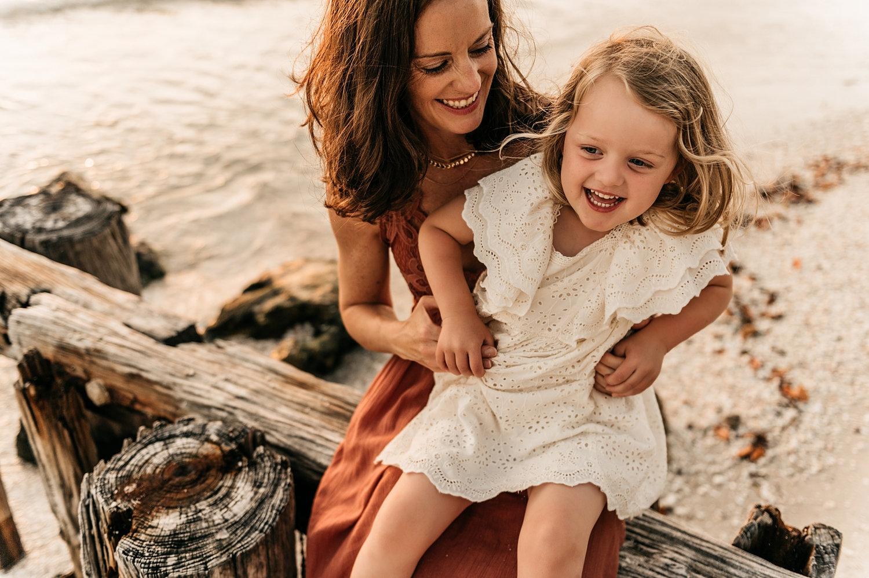 mother tickling daughter, brunette mom holding blonde little girl, Rya Duncklee