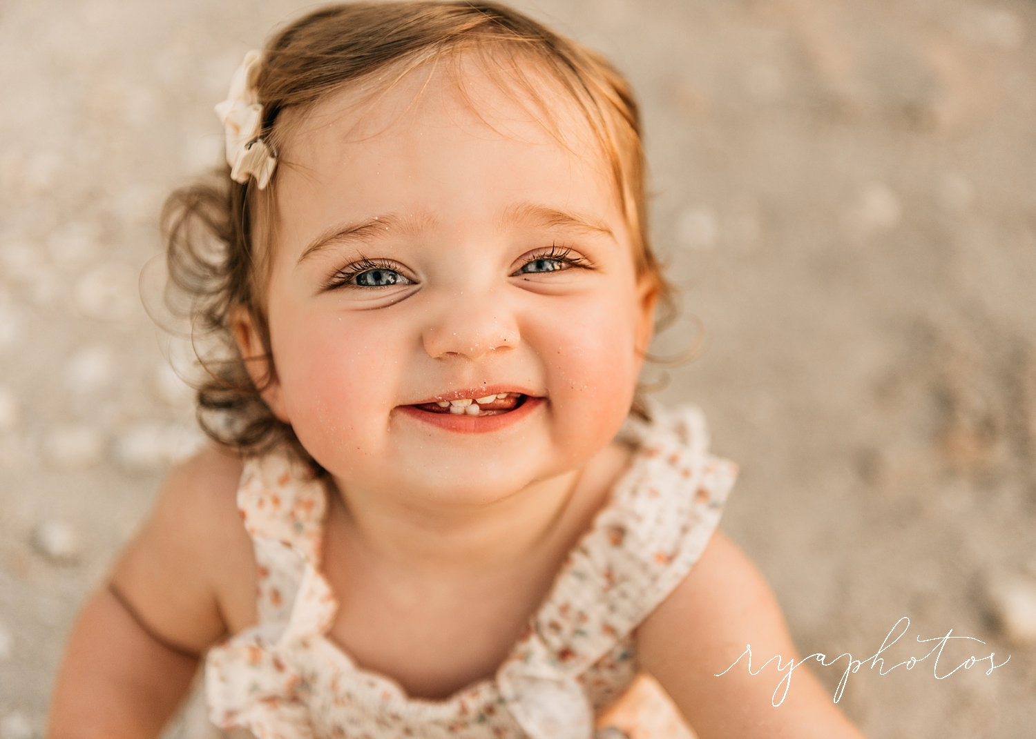 beautiful baby girl with curly hair and blue eyes, smiling baby girl, Ryaphotos