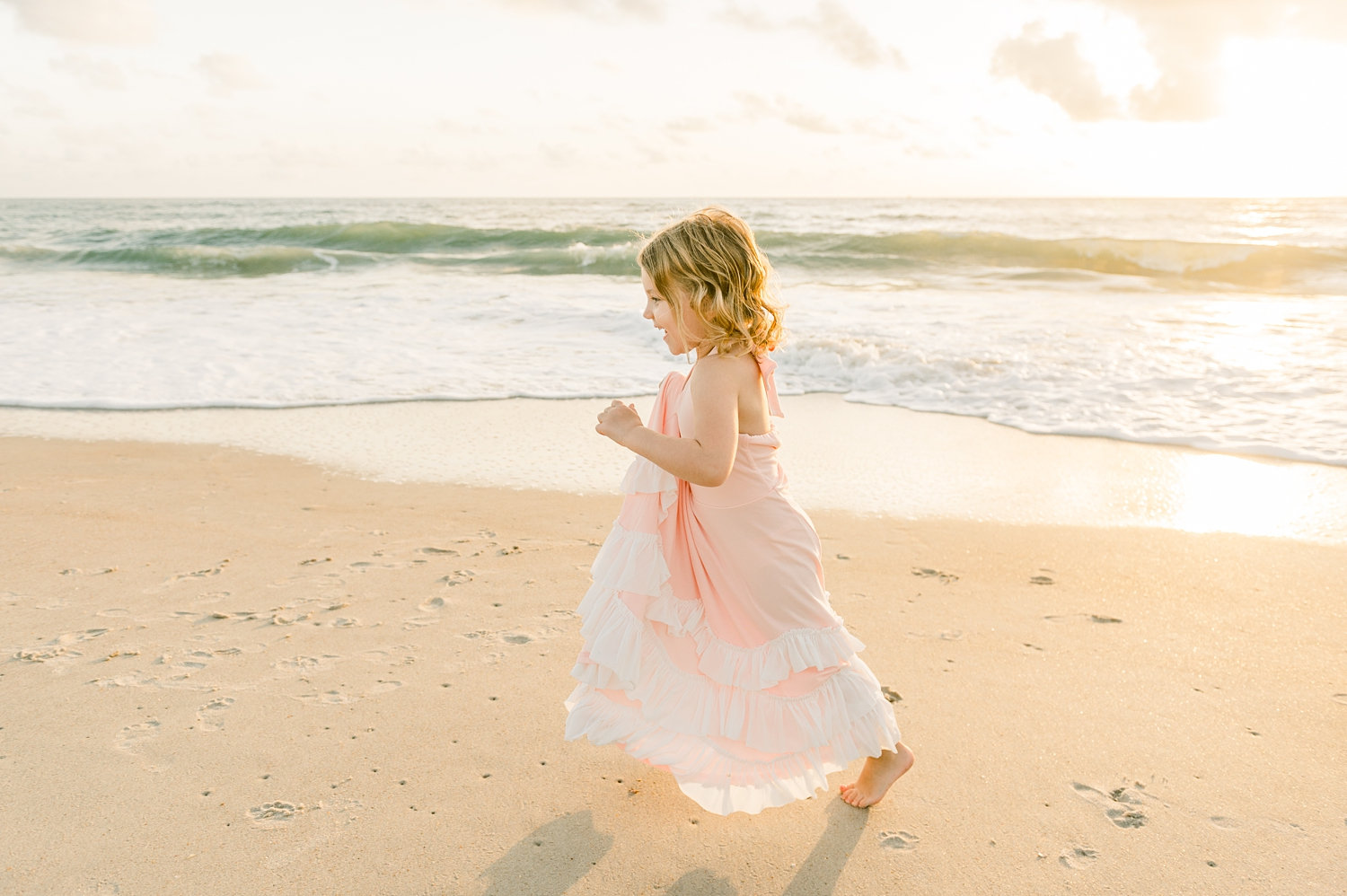 sweet little girl running along St. Augustine Beach at sunrise, Ryaphotos